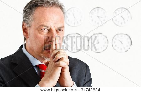 Pensive businessman trying to solve a problem on time