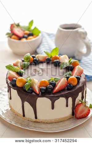 Souffle Cake With Fresh Strawberries And Blueberries, Chocolate And Mint. The Whole Cake Is Served O