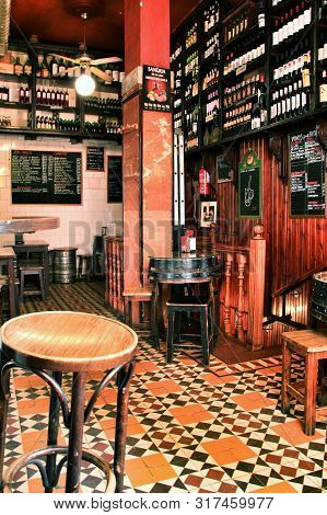 Madrid, Spain- March 7, 2019: Typical Old Spanish Wine Tavern With Wooden Tables And Chairs In Madri