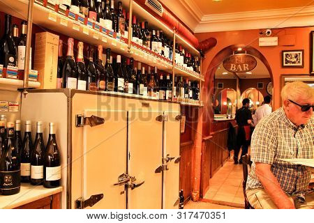 Madrid, Spain- June 14, 2019: Typical Old Spanish Wine Tavern With Wooden Tables And Chairs In Madri