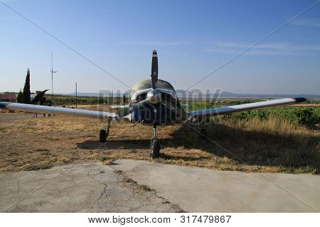 Ontur, Murcia, Spain- June 22, 2019: White And Blue Aircraft Parked In Aerodrome In A Sunny Day Of S