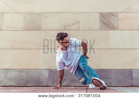 Athlete Man Dancer In A White T-shirt, Jeans Glasses, Dancing, Summer In The City, Background Wall,