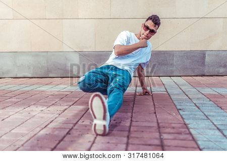 Athlete Man Dancer In A White T-shirt, Jeans And Glasses, Dancing, Summer In The City, Background Wa