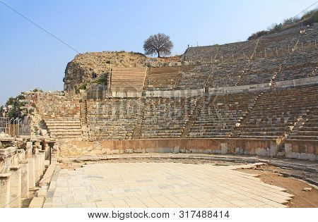 The Great Or Grand Theater In The Ancient City Ruins Of Ephesus, Turkey Near Selcuk With Blue Sky Co