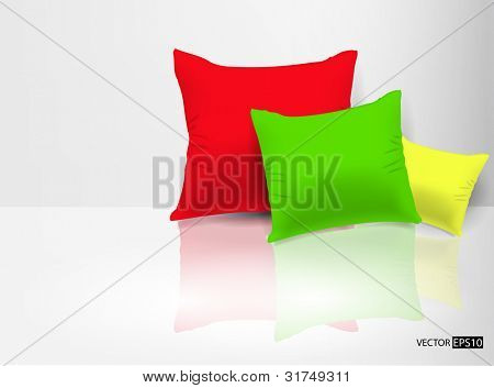 Pillows near wall on white floor