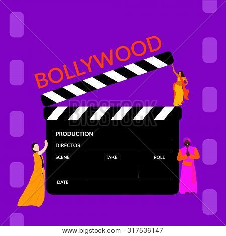 Bollywood Film Production. Clapperboard With Small Indian Tiny People Wearing Bright Colors On Film