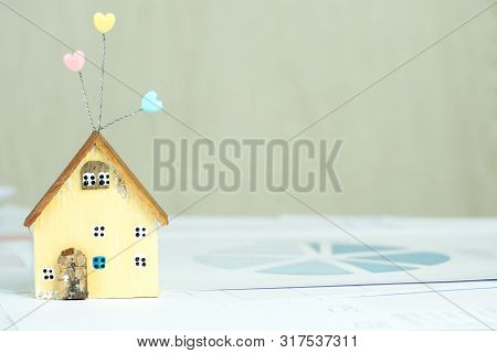 Home Décor Driftwood Ideas, Real estate property investment for house on document contract for customer on table. Mortgage application form with miniature yellow model wood home. Residental planning poster