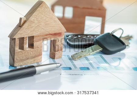 Chart Report Documents Contact To Customer With Car Key, Miniature Wood House Models. Concept Of Rea
