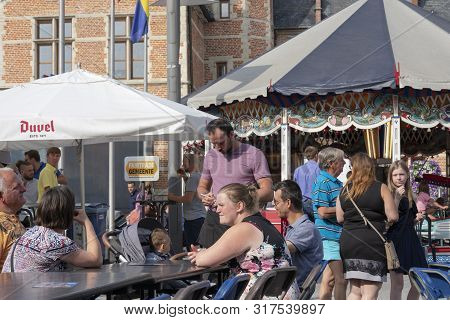 Sint Gillis Waas, Belgium, August 3, 2019, Man Takes On The Order Of Customers Who Sit At A Table On