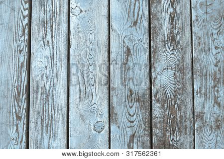 Old Wooden Ackground Of Brown Boards With Partially Erased Light  Blue Paint