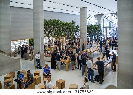 London, Uk - August 13, 2019: Interior Of The Apple Stope. Lots Of People Inside The  Apple Store On
