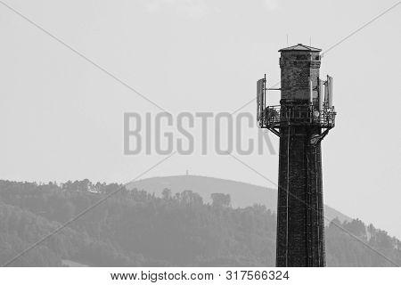 black and white photo of an old factory smokestack in Frydek-Mistek, Czech Republic poster