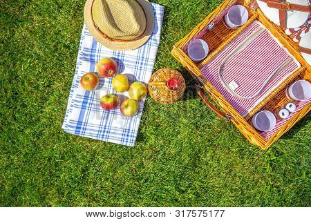 Green Lawn With Pic Nic Concept. Set Of Glasses And Plates