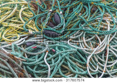 Pile Of Colorful Ropes, Nets, And Floats For Fishing, Newfoundland