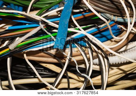 Used Electric Colorful Wires. Hank Of Different Old Cables Close Up