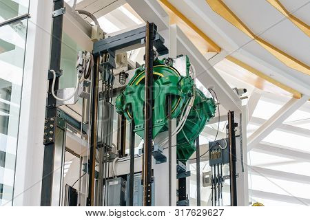 Elevator Engine Room With Elevator Motor. Motor Driven Elevator Cable Control Room. Wire Rope Cable