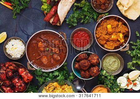 Taste Of India. A Selection Of Indian Food With Various Bowls Of Food Featuring  Chicken Tikka Masal