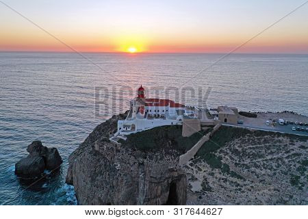 Aerial from the lighthouse Cabo Vicente in Sagres Portugal at sunset