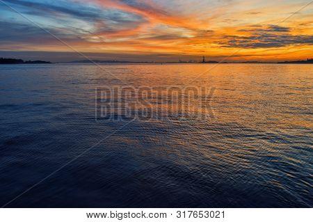 Beautiful Sunset Over A Statue Of Liberty.