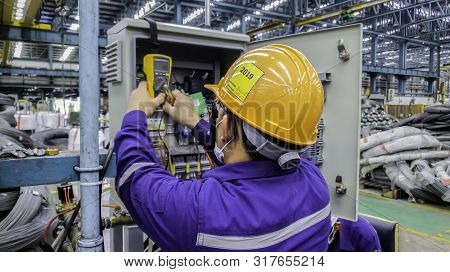 Blur Background Of Electrical Engineer Are Working On Factory Site, Technician Check Fault In Power