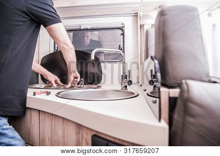 Rv Motorhome Broken And Propane Leaking Stove Repair. Caucasian Rv Technician Servicing Broken Stove