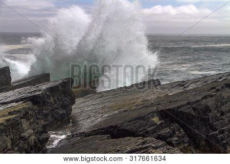 Large Wave Crashing Onto Coastal Rocks At Mistaken Point, Newfoundland