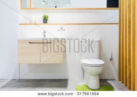 Luxury Bathroom Interior With Toilet Bowl, Mirror And Modern Basin Cabinet For Home, House, Building