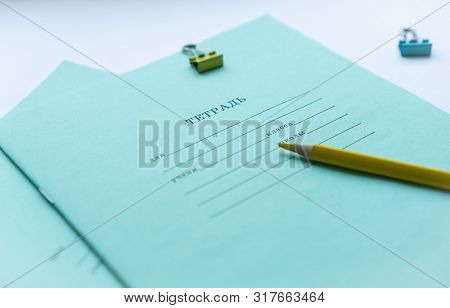 Two Pupils Copybooks With Form To Sign In: Name, Surname, Grade, Etc. With Yellow Pencil And Paper C