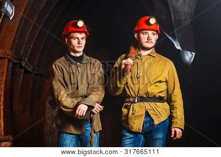 Two Miners In The Mine. Copy Space. Hard Work In A Coal Mine. Tired Workers In A Coal Mine