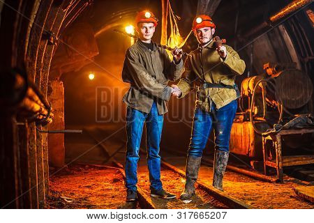 Abandoned Coal Mine. Tunnels And Passages In A Coal Mine. Coal Mine Excursion. Tired Workers In A Co
