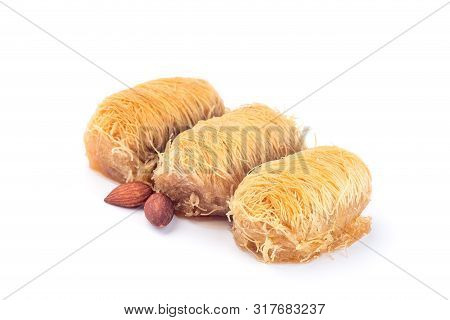 Three Greek Pastry Kataifi With Shredded Filo Dough Stuffed With Almond Nuts, In Honey Syrup, Isolat
