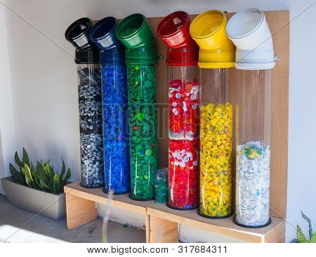 Collection And Recycling Plastic. Attempt To Solve The Environmental Problem .plastic Pet Caps Textu