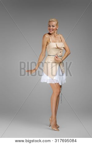 Beautiful Slim Blond Woman Holding Centimeter Measuring Tape Waistline Isolated On Gray Background