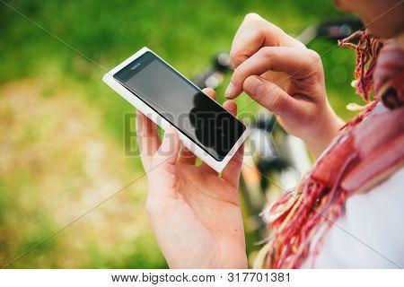 Strasbourg, France - Jun 2, 2013: Woman Using White Nokia Lumia White Smartphone Running Nokia Os Mi