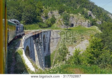 Vacance Train With People In Holiday. The Oldest Mountain Railway In Romania Inaugurated In 1863, Ro