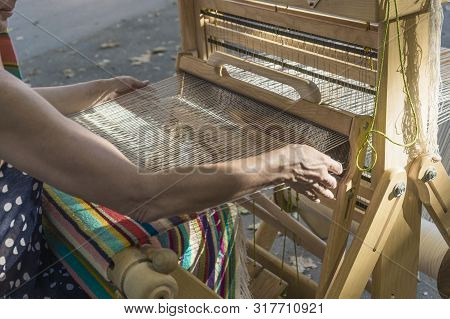 A Woman Saws On A Loom. Close-up: Weaving On A Loom, Cotton On A Hand-loom In European Traditional C