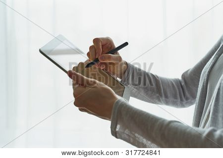 Person Signing The Document On Device, Concept Of E-signature, Modern