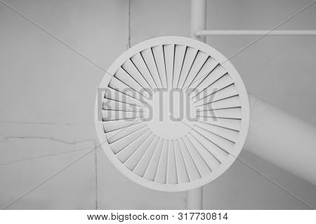 An Element Of Interior Design Is A Ceiling And A Piece Of Ventilation. Pipes, Round Ventilation Gril