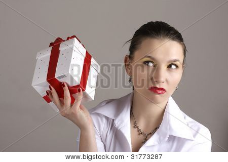 malcontented woman with a gift box