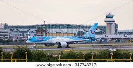 London Gatwick Airport, Uk- August 07 2019: A Tui Airways Boeing 757-200 Plane Turns Off The Runway