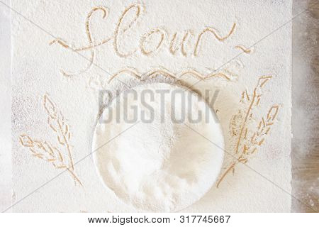 Plate With Flour On Floured Table. Hand-drawn Picture Of Ears Of Wheat And Word Flour Written On Tab