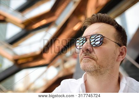 New York, Usa - July 9, 2019: Middle Age Man With Sunglasses On The Background Of Vessel (architect