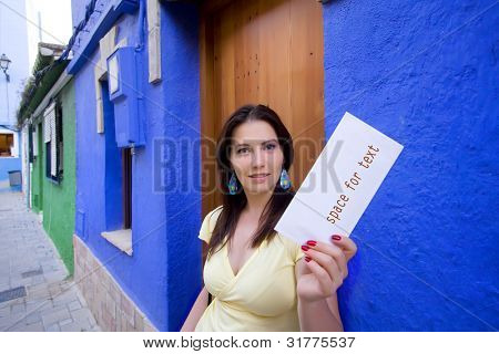 beautiful young girl holding envelope in her hands