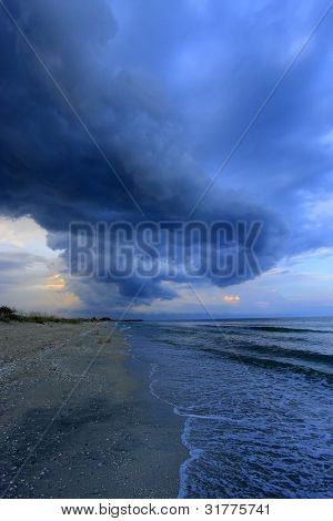 on the beach before a powerful storm