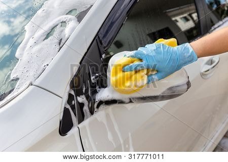 Woman Hand Wearing Blue Gloves With Yellow Sponge Washing Side Mirror Modern Car Or Cleaning Automob