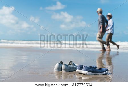 Shoe On Sand Of Couple Senior Elder Retire Resting Relax Walking Running At Sunset Beach Honeymoon F