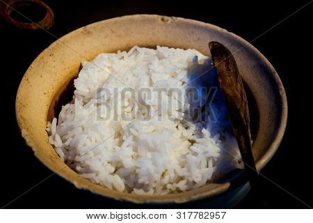 Cooked Rice In Bowl With Spoon .
