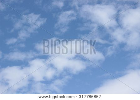 Beautiful clouds floating on the vast blue of the sky poster