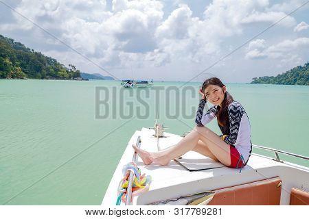 Surin Islands, Phang Nga Province, Thailand - May 2019 : Happy Girl Setting On Boat At Surin Islands