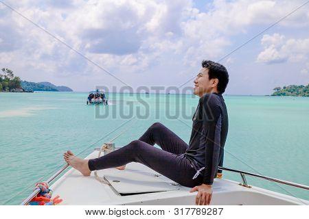 Surin Islands, Phang Nga Province, Thailand - May 2019 : Happy Man Setting On Boat At Surin Islands,